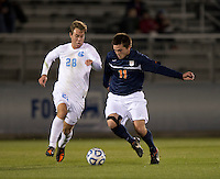 Alex Olofson (28) of North Carolina closes in on Eric Bird (11) of Virginia during the game at the Maryland SoccerPlex in Germantown, MD. North Carolina defeated Virginia on penalty kicks after playing to a 0-0 tie in regulation time.  With the win the Tarheels advanced to the finals of the ACC men's soccer tournament.