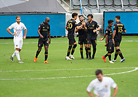 LOS ANGELES, CA - OCTOBER 25: Carlos Vela #10 of LAFC celebrates his goal with teammates during a game between Los Angeles Galaxy and Los Angeles FC at Banc of California Stadium on October 25, 2020 in Los Angeles, California.