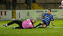 Forfar's Dale Hilson goes in late on Stirling keeper Callum Reidford.