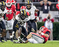 ATHENS, GA - NOVEMBER 09: Jake Fromm #11 of the Georgia Bulldogs recovers a fumbled snap during a game between Missouri Tigers and Georgia Bulldogs at Sanford Stadium on November 09, 2019 in Athens, Georgia.