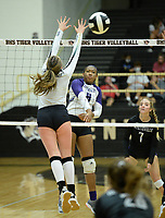 Fayetteville's Rosana Hicks (8) sends the ball over the net Tuesday, Sept. 15, 2020, as Bentonville's Reagan Tunnell (left) defends during play in Tiger Arena in Bentonville. Visit nwaonline.com/200916Daily/ for today's photo gallery. <br /> (NWA Democrat-Gazette/Andy Shupe)