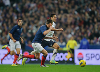 Laurent Koscielny of France and Clint Dempsey of team USA fight for the ball during the friendly match France against USA at the Stade de France in Paris, France on November 11th, 2011.