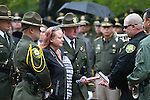 Carson City Sheriff's Deputy Dan Jones, right center, gives a baton to fallen Dep. Carl Howell's widow Rachel during the annual Law Enforcement Officers Memorial Ceremony on the Capitol grounds in Carson City, Nev. on Thursday, May 5, 2016. The name of Carson City Sheriff's Deputy Carl Howell was added to the memorial after he was killed in the line of duty in Aug. 2015.<br /> Photo by Cathleen Allison/Nevada Photo Source