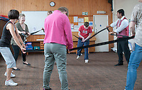 Tutor, carers and participants all join in, Movement & Music, Learning Support group with their carers,  Adult Learning Centre, Guildford, Surrey.