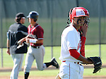 A disappointed Savanagh High School pitcher walks back to the mound after giving up a homerun.