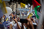 Pope Francis gestures as he arrives to celebrates mass with thousands of worshipers in Manger Square in the West Bank city of Bethlehem Sunday May 25 2014. Pope Francis is on a three day visit to the region. Photo by Eyal Warshavsky