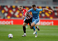 17th October 2020; Brentford Community Stadium, London, England; English Football League Championship Football, Brentford FC versus Coventry City; Dominic Hyam of Coventry City challenges Sergi Canos of Brentford for a through ball