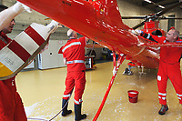 "Switzerland. Canton Ticino. Locarno Airport LSZL. The Rega base's official name is Locarno LSMO AFB (Rega 6). Left to right: Doctor Michele Musiari, paramedic Paolo Menghetti and pilot Corrado Sasselli. The crew is cleaning the tail of a Rega Agusta AW109 SP Grand ""Da Vinci"" helicopter. All Rega helicopters carry a crew of three: a pilot, an emergency physician, and a paramedic who is also trained to assist the pilot for radio communication, navigation, terrain/object avoidance, and winch operations. The name Rega was created by combining letters from the name ""Swiss Air Rescue Guard"" as it was written in German (Schweizerische Rettungsflugwacht), French (Garde Aérienne Suisse de Sauvetage), and Italian (Guardia Aerea Svizzera di Soccorso). Rega is a private, non-profit air rescue service that provides emergency medical assistance in Switzerland. Rega mainly assists with mountain rescues, though it will also operate in other terrains when needed, most notably during life-threatening emergencies. As a non-profit foundation, Rega does not receive financial assistance from any government. The AgustaWestland AW109 is a lightweight, twin-engine, helicopter built by the Italian manufacturer Leonardo S.p.A. (formerly AgustaWestland, Leonardo-Finmeccanica and Finmeccanica). Leonardo S.p.A is an Italian global high-tech company and one of the key players in aerospace. In close collaboration with the manufacturer, the Da Vinci has been specially designed to cater for Rega's particular requirements as regards carrying out operations in the mountains. It optimally fulfills the high demands made of it in terms of flying characteristics, emergency medical equipment and maintenance. Safety, performance and space have been increased, and maintenance and noise emissions reduced. 10.09.2017 © 2017 Didier Ruef"