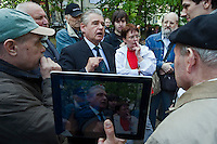 Moscow, Russia, 15/05/2012..A passer-by debates with protesters in Chistiye Prudy, or Clean Ponds, as a Moscow court ordered the eviction of some 200 opposition activists who have set up camp in the city centre park.