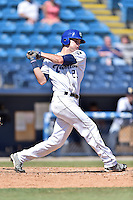 Asheville Tourists right fielder Sam Hilliard (25) swings at a pitch during a game against the Charleston RiverDogs at McCormick Field on July 10, 2016 in Asheville, North Carolina. The Tourists defeated the RiverDogs 4-2. (Tony Farlow/Four Seam Images)