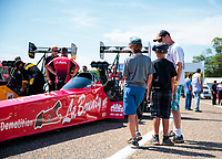 Aug 17, 2019; Brainerd, MN, USA; NHRA fans look at the dragster of top fuel driver Doug Kalitta during qualifying for the Lucas Oil Nationals at Brainerd International Raceway. Mandatory Credit: Mark J. Rebilas-USA TODAY Sports