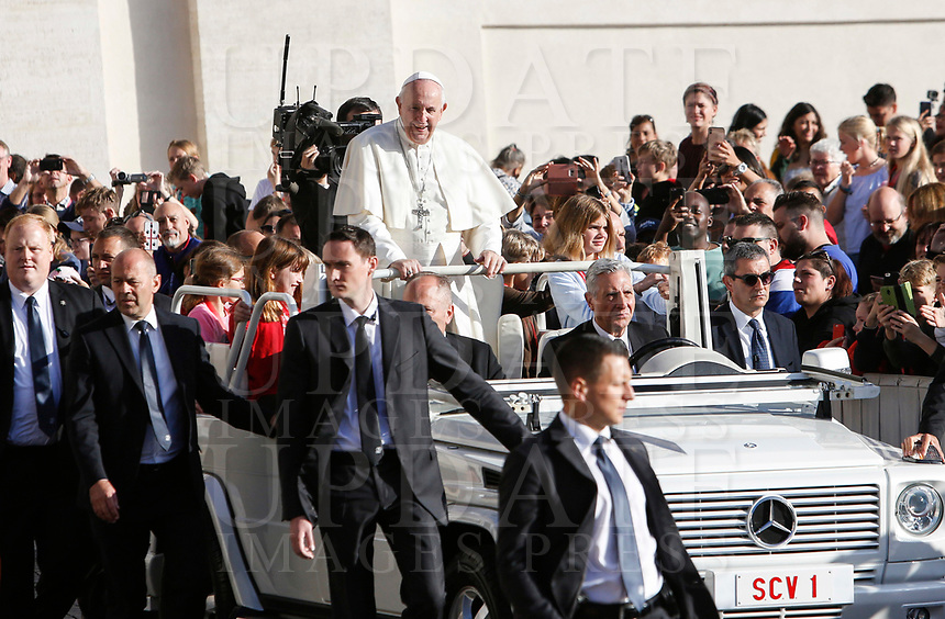 Pope Francis waves to the faithful as he arrives to attend his weekly general audience in St. Peter's Square at the Vatican City, October 16, 2019. At right, with sunglasses, new Vatican head of security Gianluca Gauzzi Broccoletti.<br /> UPDATE IMAGES PRESS/Riccardo De Luca<br /> <br /> STRICTLY ONLY FOR EDITORIAL USE