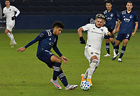 KANSAS CITY, KS - OCTOBER 24: #26 Jaylin Lindsey of Sporting Kansas City and #11 Diego Rubio of the Colorado Rapids jockey for possession of the ball during a game between Colorado Rapids and Sporting Kansas City at Children's Mercy Park on October 24, 2020 in Kansas City, Kansas.