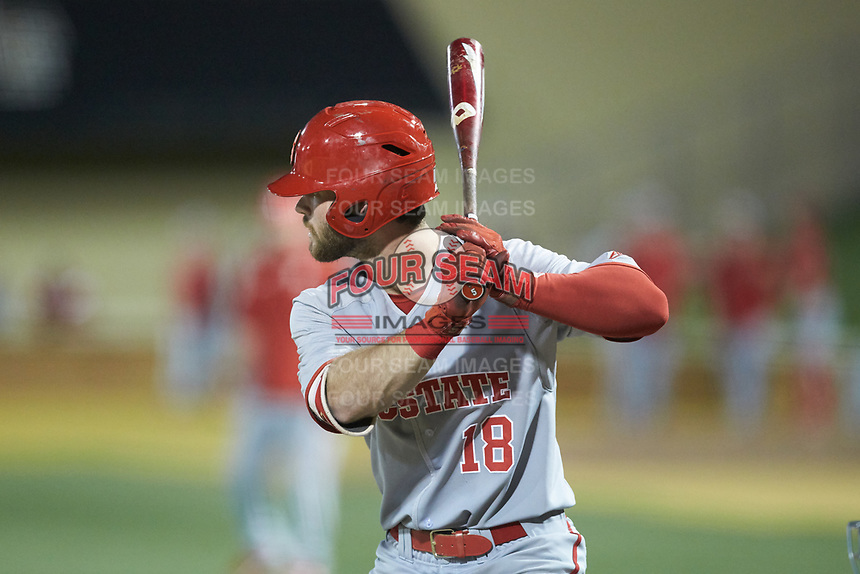 Evan Edwards (18) of the North Carolina State Wolfpack at bat against the Wake Forest Demon Deacons at David F. Couch Ballpark on April 18, 2019 in  Winston-Salem, North Carolina. The Demon Deacons defeated the Wolfpack 7-3. (Brian Westerholt/Four Seam Images)