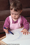 18 month old toddler girl art activity scribbing with crayons vertical