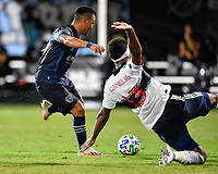 LAKE BUENA VISTA, FL - JULY 26: Roger Espinoza of Sporting KC has his shot contested by Derek Cornelius of Vancouver Whitecaps FC during a game between Vancouver Whitecaps and Sporting Kansas City at ESPN Wide World of Sports on July 26, 2020 in Lake Buena Vista, Florida.