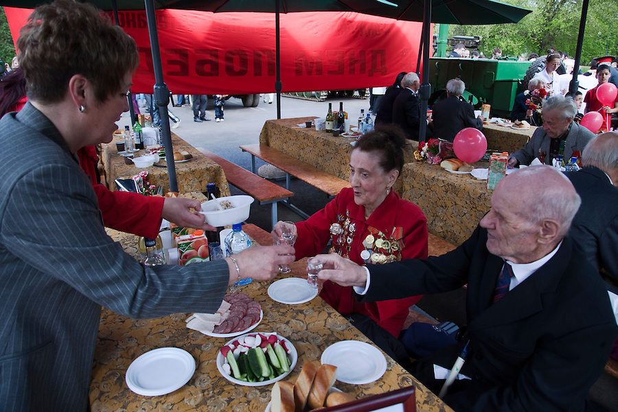 Moscow, Russia, 09/05/2011..Russian World War Two veterans toast and eat from an amy mobile canteen as they gather in Gorky Park during the country's annual Victory Day celebrations.