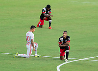 WASHINGTON, DC - SEPTEMBER 12: Ola Kamara #9 of D.C. United kneels during a game between New York Red Bulls and D.C. United at Audi Field on September 12, 2020 in Washington, DC.