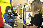 A store clerk helps a shopper use sanitary measures in the Xanadu Shopping Center in Madrid on the day of its reopening during the beginning of Phase 2 of the unconfinement during the health crisis due to the Covid-19 - Coronavirus pandemic. June 8,2020. (ALTERPHOTOS/Ricardo Blanco)