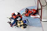 Ryo Miyazaki of Empire Skate (C) battle in the goal mouth with Thomas Sorensen of Singapore Hawkers (L) during the Mega Ice Hockey 5s match between Singapore Hawkers and Empire Skate on May 04, 2018 in Hong Kong, Hong Kong. Photo by Marcio Rodrigo Machado / Power Sport Images