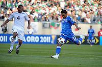 El Salvador's Lester Blanco shoots in front of Cuba's Hanier Dranguet.  El Salvador defeated Cuba 6-1 at the 2011 CONCACAF Gold Cup at Soldier Field in Chicago, IL on June 12, 2011.