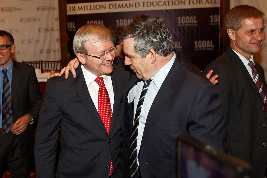 Australian Foreign Minister Kevin Rudd is greeted by former British Prime Minister Gordon Brown after a panel discussion at the 1GOAL education forum in New York. photo by Trevor Collens
