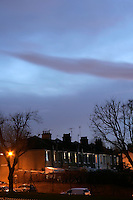 Southeast London street with terraced houses at night, UK