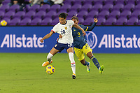 ORLANDO, FL - JANUARY 22: Alana Cook #28 protects the ball from Kena Romero #9 during a game between Colombia and USWNT at Exploria stadium on January 22, 2021 in Orlando, Florida.