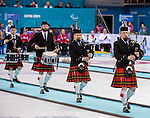 Sochi, RUSSIA - Mar 10 2014 -  Bagpipers lead in the teams before Canada vs Norway in Wheelchair Curling round robin play at the 2014 Paralympic Winter Games in Sochi, Russia.  (Photo: Matthew Murnaghan/Canadian Paralympic Committee)