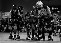 San Francisco ShEvil Dead & the Oakland Outlaws roller derby teams jockey for position as a new play begins during the second half of the Bay Area Derby Girls season opener...(©Matt McKnight, 2008).