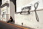 Economic Crisis in Buenos Aires Argentina South America 2002 2000s mural pot bangers symbol of the protest movement <br /> Economic Turmoil in Argentina<br /> A graffiti artist has drawn a huge saucepan and spoon that beats the pan on the El Cabildo which is the historic heart of the independence movement. This is the symbol of the Cacerolazo, the pot-bangers. Inside this graffiti saucepan are the heads of the