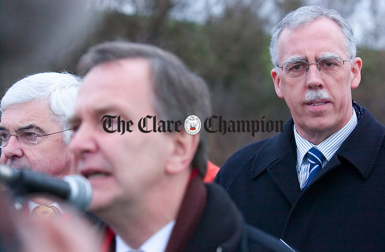 Minister for Labour Affairs Tony Killeen TD listens to the speech of  Minister for Transport Martin Cullen TD at the official opening of the N18 Ennis Bypass.Pic Arthur Ellis.