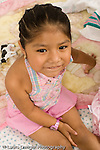 portrait of 3 year old girl vertical Mexican American