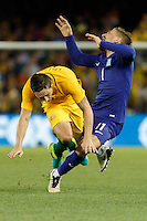 June 7, 2016: KONSTANTINOS STAFYLIDIS (11) of Greece collides with MARK MILLIGAN (5) of Australia  during an international friendly match between the Australian Socceroos and Greece at Etihad Stadium, Melbourne. Photo Sydney Low