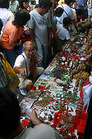 A Taiwanese vendor makes a clean profit pandering to people's craving for things that would bring them luck as he sells all manner of charms on Ongpin St., Binondo, Manila as the Filipino-Chinese community ushers in the Year of the Rooster. 2 February 2004