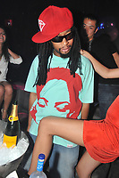 MIAMI - August 21:  (EXCLUSIVE COVERAGE) Rapper Lil Jon parties at Mynt nightclub on Southbeach with Model Blond model Porsche Lee. on August 21, 2009 in Miami, Florida. <br /> <br /> People:   Lil Jon, Porsche Lee
