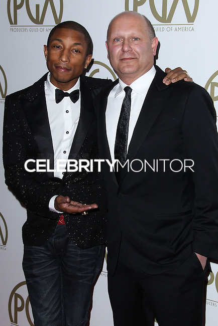 BEVERLY HILLS, CA - JANUARY 19: Pharrell Williams, Christopher Meledandri at the 25th Annual Producers Guild Awards held at The Beverly Hilton Hotel on January 19, 2014 in Beverly Hills, California. (Photo by Xavier Collin/Celebrity Monitor)