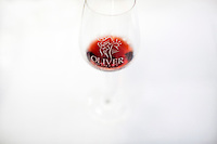 A glass of Oliver wine is seen during Oliver Winery's Harvest Wine Festival on Saturday, Sept.. 25, 2014. (Photo by James Brosher)