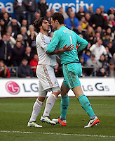 (L-R) Alberto Paloschi of Swansea squares up with Asmir Begovic of Chelsea during the Barclays Premier League match between Swansea City and Chelsea at the Liberty Stadium, Swansea on April 9th 2016