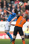Dundee United v St Johnstone.....21.02.15<br /> Chris Kane gets above Jaroslaw Fojut<br /> Picture by Graeme Hart.<br /> Copyright Perthshire Picture Agency<br /> Tel: 01738 623350  Mobile: 07990 594431