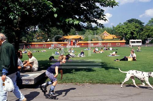 Zurich, Switzerland. Lake Zurich; people resting on the grass; walking dogs; roller skating.