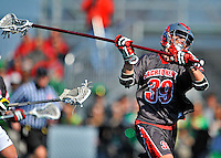 17 March 2012: Sacred Heart University Pioneer Defender Pat Fletcher, a Junior from Silver Spring, MD, in action against the University of Vermont Catamounts at Virtue Field in Burlington, Vermont. The visiting Pioneers rallied to tie the score at 11 with five unanswered goals, dominating the 4th period. However the Cats scored with only 10 seconds remaining in the game to defeat the Pioneers 12-11 in their non-conference matchup. Mandatory Credit: Ed Wolfstein Photo