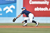 Asheville Tourists shortstop Brendan Rodgers (1) reacts to the ball during a game against the Charleston RiverDogs at McCormick Field on July 9, 2016 in Asheville, North Carolina. The RiverDogs defeated the Tourists 10-9. (Tony Farlow/Four Seam Images)