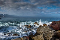 Fine Art Landscape Photograph of a seascape scene in Puerto Vallarta Mexico. The morning lighting was perfect as the long rays of the morning sun brought out the textures and details of clouds, and the ocean waves crashing down onto the rocky shoreline.
