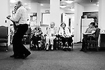 CHAD PILSTER •Hays Daily News<br /> <br /> Treva Benoit, left, the Director, dances with Earl Brenner, a guest, as (left to right) Lois Wheeler, resident, Bea Seba, resident, Cletis Hammerschmidt, resident, Marie Litzenberger, resident, Dorothy Fulton, family member, watch on Thursday, October 17, 2013 as polka music is played by the Wes Windholz Band at the Cedar View Assisted Living Residence in Hays, Kansas. The Wes Windholz Band plays the third Thursday of every month at area retirement homes.