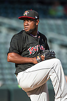 Albuquerque Isotopes starting pitcher Yohan Flande (45) delivers a pitch to the plate against the Salt Lake Bees in Pacific Coast League action at Smith's Ballpark on June 8, 2015 in Salt Lake City, Utah. The Bees defeated the Isotopes 10-7 in game one of a double-header. (Stephen Smith/Four Seam Images)