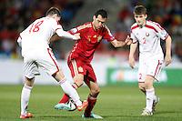 Spain's Sergio Busquets (c) and Belarus' Sergei Politevich (l) and Stanislav Dragun during 15th UEFA European Championship Qualifying Round match. November 15,2014.(ALTERPHOTOS/Acero) /NortePhoto nortephoto@gmail.com