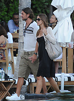 "SMG_FLXX_Paolo Maldini_ Adriana Fossa_Poolside_010112_01.JPG<br /> <br /> MIAMI BEACH, FL - JANUARY 1: Paolo Maldini and wife  Adriana Fossa poolside at their hotel in Miami.   Paolo Cesare Maldini (born 26 June 1968) is an Italian former footballer who played as a left or central defender, being adept with either foot although naturally right footed. He spent all 25 seasons of his career at Serie A club Milan, before retiring at the age of 41 in 2009, becoming a symbol and a legend of the club. During that period, he won the Champions League five times, as well as seven Serie A titles, one Coppa Italia, five Supercoppa Italiana, five European Super Cups, two Intercontinental Cups. He played for 14 years for the Italian national team, making his debut in 1988 before retiring in 2002 with 126 caps and four World Cup participations.<br /> <br /> Maldini played at a world class level for his entire career spanning 2 and a half decades, and won the Best Defender trophy at the UEFA Club Football Awards at the age of 39. He came second to George Weah for the FIFA World Player of the Year Award in 1995, the closest a defender had ever reached to winning the award at the time. He was also the Milan and Italy captain for many years and was considered a leader amongst leaders by fellow footballers, leading to the nickname ""Il Capitano"" (the Captain). Paolo's father Cesare formerly played for and captained Milan, and is a successful national U-21 manager.   on January 01, 2012 in Miami Beach, Florida  (Photo By Storms Media Group)   <br /> <br /> People:  Paolo Maldini_ Adriana Fossa<br /> <br /> Transmission Ref:  FLXX<br /> <br /> Must call if interested<br /> Michael Storms<br /> Storms Media Group Inc.<br /> 305-632-3400 - Cell<br /> 305-513-5783 - Fax<br /> MikeStorm@aol.com"