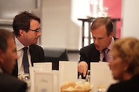 September 26 2012 - Montreal Quebec CANADA - Louis Audet, President & CEO of COGECO et Cogeco Cable,discuss with Pierre-Karl Peladeau, CEO QUEBECOR before speaking at the Canadian Club of Montreal's podium.<br /> <br /> What is Cogeco? A cable distributor? A broadcaster? No one can claim to truly know this major telecommunications industry player better than its President and CEO, Louis Audet. Under his guidance, Cogeco Cable has become the second-largest cable distribution company in Québec and Ontario, serving nearly 900,000 subscribers from Gaspé to Windsor. Cogeco Cable, through Cogeco Data Services, operates data centres for its business customers in both provinces. Today, Cogeco Diffusion, a COGECO Inc. affiliate company, is a leading Quebec radio broadcaster with 13 stations and provides news services to 47 radio stations across the province. Through Cogeco Métromédia, the company also offers specialized media representation services in the public transit signage sector in major Québec and Canadian cities. In addition, within a very few months Cogeco Cable will expand its cable distribution operations to the United States following its recent acquisition of Atlantic Broadband.