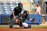 Umpire Nobuoki Yasuta and FCL Pirates Black catcher Henry Davis (32) await the first pitch in the bottom of the first inning during a game against the FCL Rays on August 3, 2021 at Charlotte Sports Park in Port Charlotte, Florida.  Davis was making his professional debut after being selected first overall in the MLB Draft out of Louisville by the Pittsburgh Pirates.  (Mike Janes/Four Seam Images)